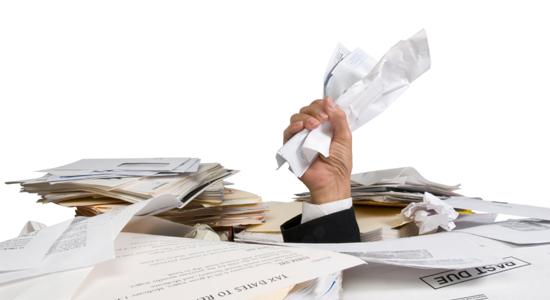 Businessman Buried in Paperwork
